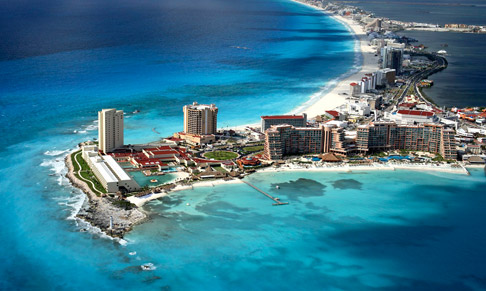 aerial view of cancun resort surrounded by ocean