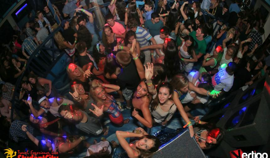 overhead shot of a group of high school students dancing in a club on Spring break