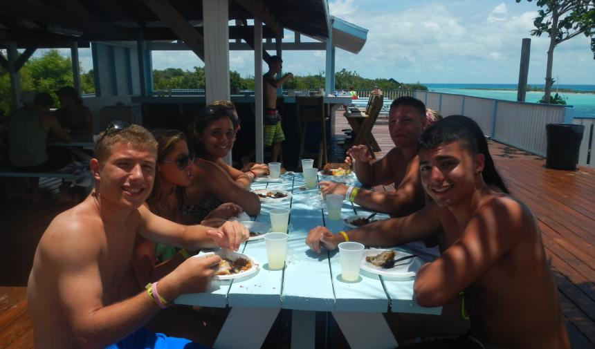 high school students eating at a picnic table in Nassau