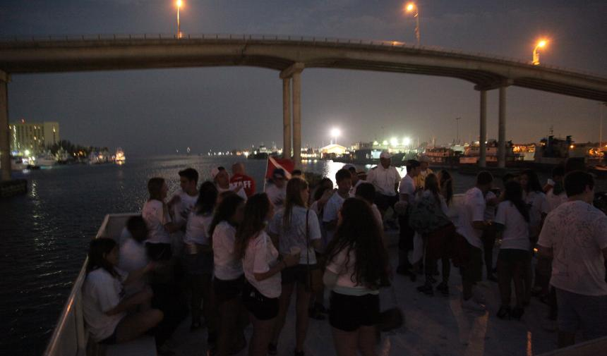 A group of students enjoying an evening in Nassau, on their graduation trip.