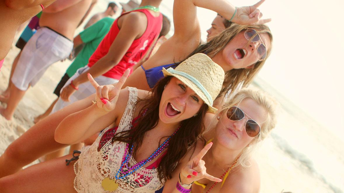 girls posing for a photo during their high school spring break in Panama City Beach