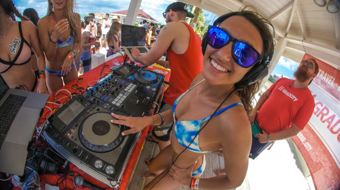 High Schooler spinning the turn tables on the beach.