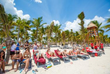 Students on the beach at a family friendly resort in Punta Cana